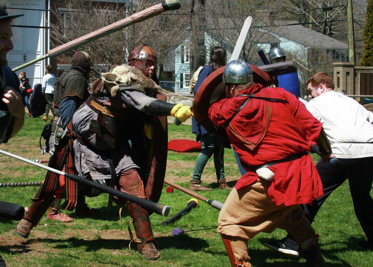 Peter Nikel, left, battles Joshua Taylor in a gathering called Dagorhir which is live action role play during the 7th Annual Maker Faire Westport in downtown Westport, Conn., on Saturday Apr. 21, 2018.