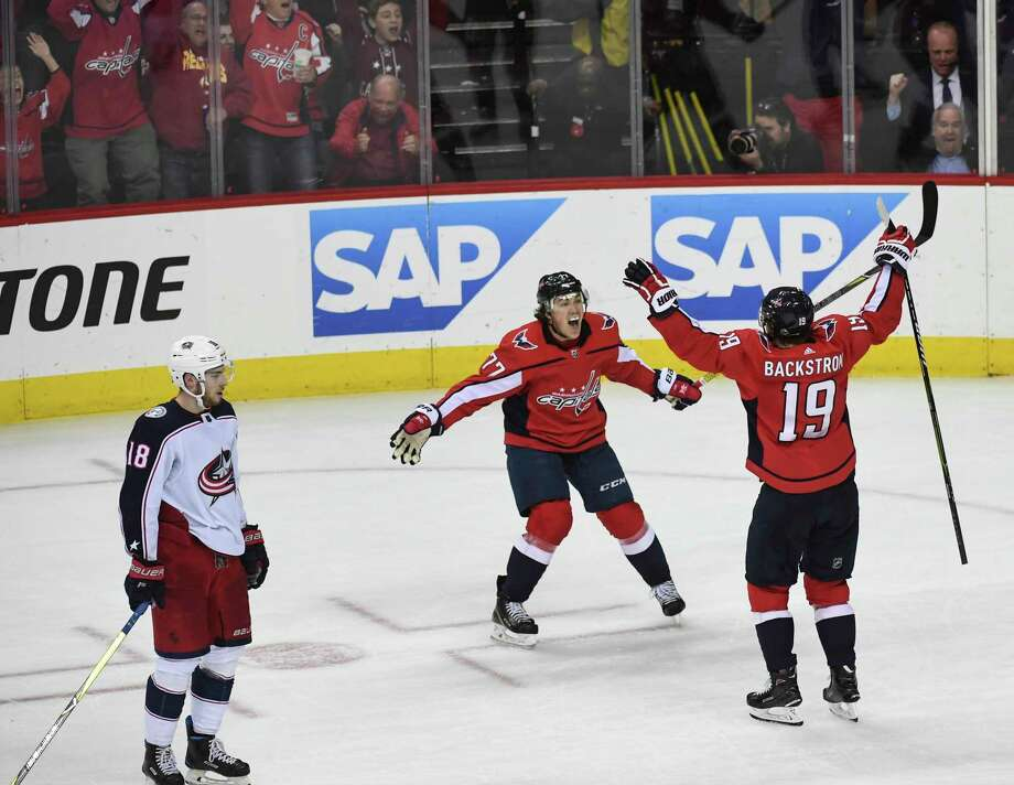 5f220e2ed17 Capitals right wing T.J. Oshie (77) and center Nicklas Backstrom (19)  celebrate