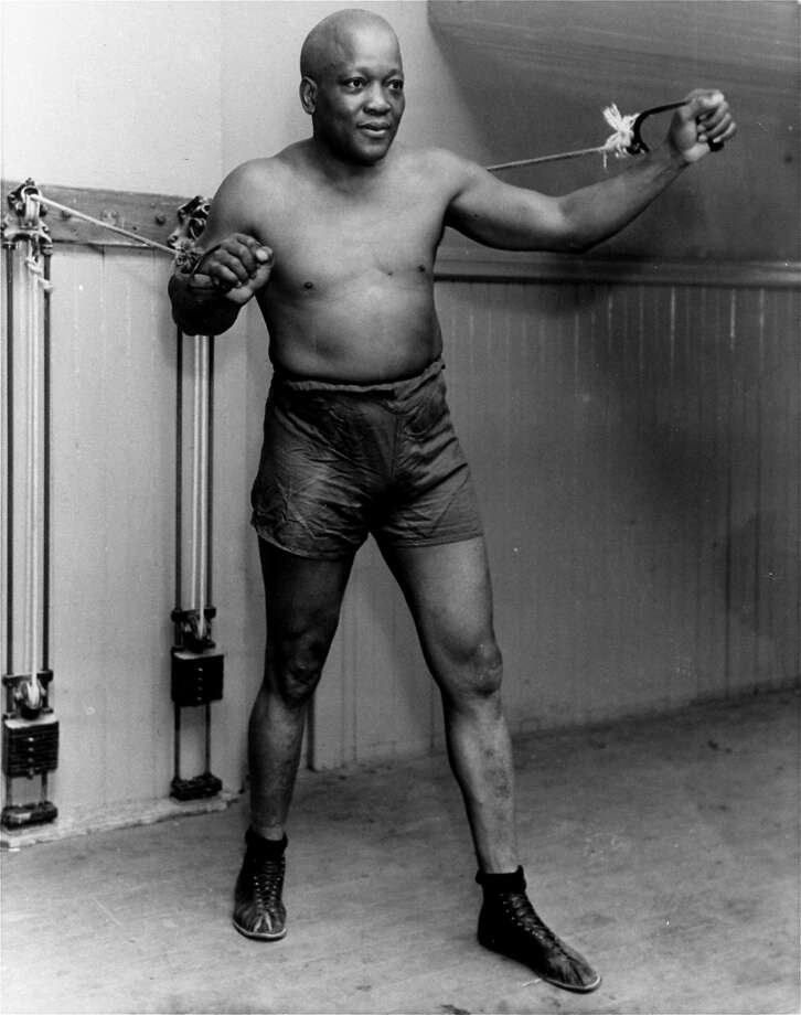 FILE - In this 1932 file photo, boxer Jack Johnson, the first black world heavyweight champion, poses in New York City.  Black athletes have been finding a way to fight for social change for more than 100 years, from Jack Johnson, to Muhammad Ali to Kaepernick. (AP Photo/File) Photo: Associated Press 1932