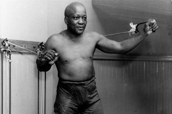 FILE - In this 1932 file photo, boxer Jack Johnson, the first black world heavyweight champion, poses in New York City.  Black athletes have been finding a way to fight for social change for more than 100 years, from Jack Johnson, to Muhammad Ali to Kaepernick. (AP Photo/File)