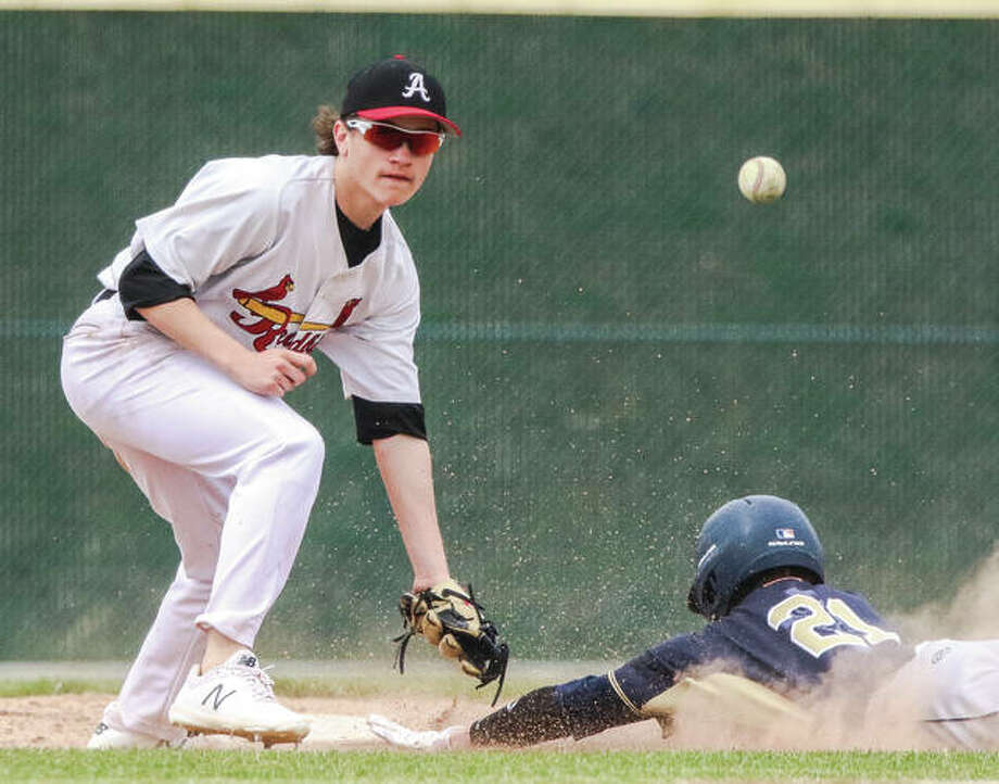 Alton second baseman Caleb Noble (left) takes the throw as Belleville Althoff's Josh Dima dives in safely for a stolen base Saturday at Alton High in Godfrey. Photo:       Nathan Woodside / For The Telegraph