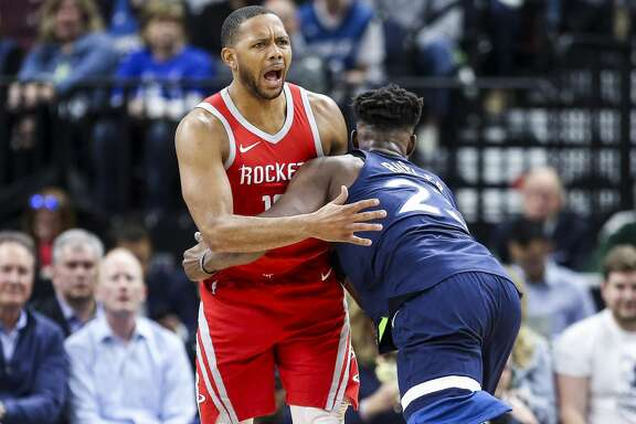 Houston Rockets guard Chris Paul (3) is knocked to the ground and called for a foul as Minnesota Timberwolves guard Jimmy Butler (23) ends up in the arms of a reacting Houston Rockets guard Eric Gordon (10) as the Houston Rockets take on the Minnesota Timberwolves in Game 3 of the first round of the NBA Playoffs at Target Center Saturday, April 21, 2018 in Minneapolis. (Michael Ciaglo / Houston Chronicle)