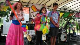 Sandra Garza, a first-place winner in the 3rd annual Mission Reach Flotilla Festival's decorate yourself category, stands with other winners holding her trophy, a paddle. Photo by Sig Christenson