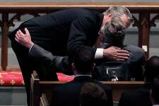 HOUSTON, TX - APRIL 21: Former Florida Governor Jeb Bush comforts his father, former President George H.W. Bush during a funeral service for his mother, former first lady Barbara Bush at St. Martin's Episcopal Church, April 21, 2018 in Houston, Texas. Bush, wife of former president George H. W. Bush and mother of former president George W. Bush, died at her home in Houston on April 17 at the age of 92.  (Photo by David J. Phillip-Pool/Getty Images)