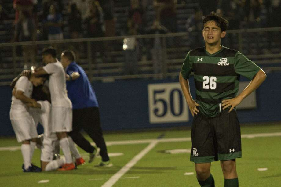 Reagan player Freshman	midfielder Fabrizio Bernal (26) gets emotional after their loss to Alief Elsik during their UIL 6A boys State semifinal soccer game at Birkelbach Field on April 21, 2018 in Georgetown, Texas. Photo: Thao Nguyen, For San Antonio Express-News / Thao Nguyen