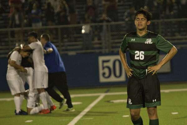 Reagan player Freshman	midfielder Fabrizio Bernal (26) gets emotional after their loss to Alief Elsik during their UIL 6A boys State semifinal soccer game at Birkelbach Field on April 21, 2018 in Georgetown, Texas.