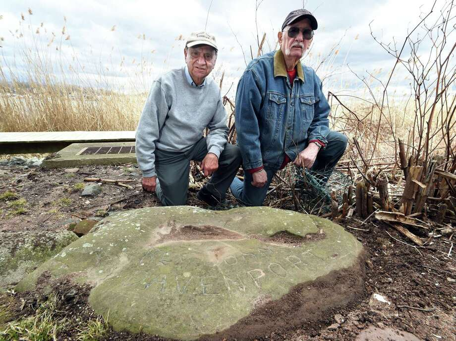 Charlie Salerno (left) and Anthony Griego by a boundary stone marking a border of the Rev. John Davenport's farm near the banks of the Quinnipiac River in New Haven. Photo: Arnold Gold / Hearst Connecticut Media / New Haven Register