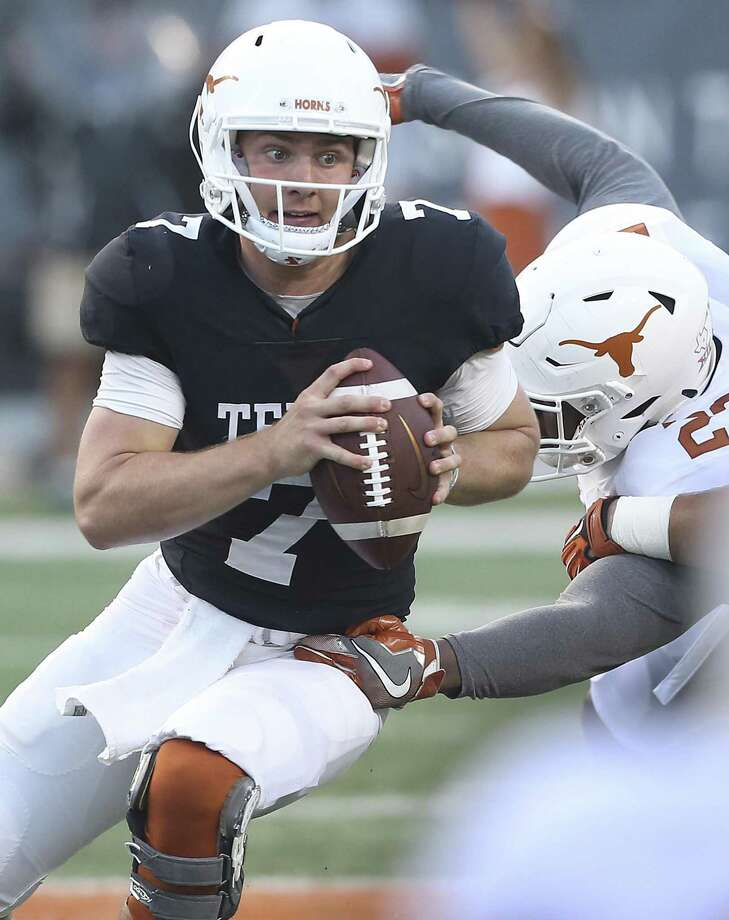 Shane Buechele evades defenders at the UT Orange-White Spring Game at DKR Stadium on April 21, 2018. Photo: Tom Reel, Staff / San Antonio Express-News / 2017 SAN ANTONIO EXPRESS-NEWS