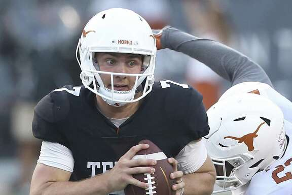 Shane Buechele evades defenders at the UT Orange-White Spring Game at DKR Stadium on April 21, 2018.