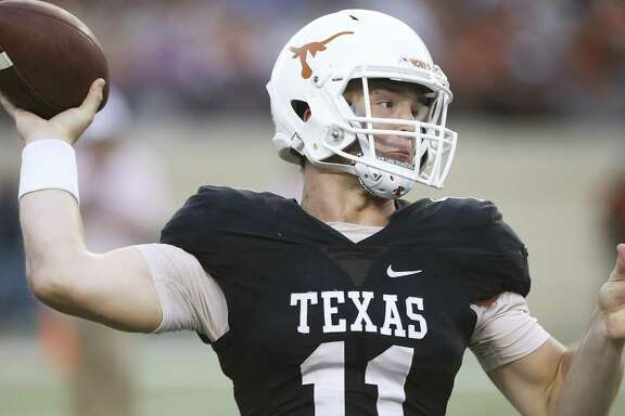Sam Ehlinger picks a receiver at the UT Orange-White Spring Game at DKR Stadium on April 21, 2018.