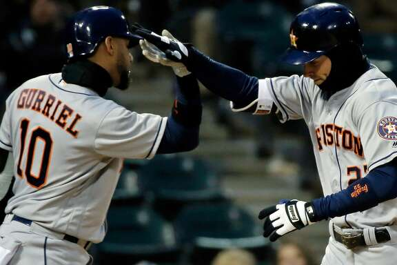 CHICAGO, IL - APRIL 21: Josh Reddick #22 of the Houston Astros is congratulated by Yuli Gurriel #10 (L) after hitting a home run against the Chicago White Sox during the fourth inning at Guaranteed Rate Field on April 21, 2018 in Chicago, Illinois.  (Photo by Jon Durr/Getty Images)