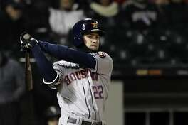 Houston Astros' Josh Reddick watches after hitting a foul against the Chicago White Sox during the sixth inning of a baseball game Saturday, April 21, 2018, in Chicago. (AP Photo/Nam Y. Huh)