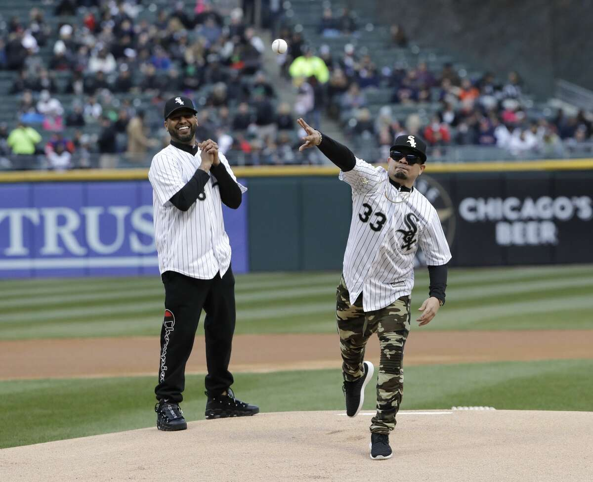 Joel Munoz, right, throws the ceremonial first pitch as Randy Ortiz watches before a baseball game between the Houston Astros and the Chicago White Sox, Saturday, April 21, 2018, in Chicago.(AP Photo/Nam Y. Huh)