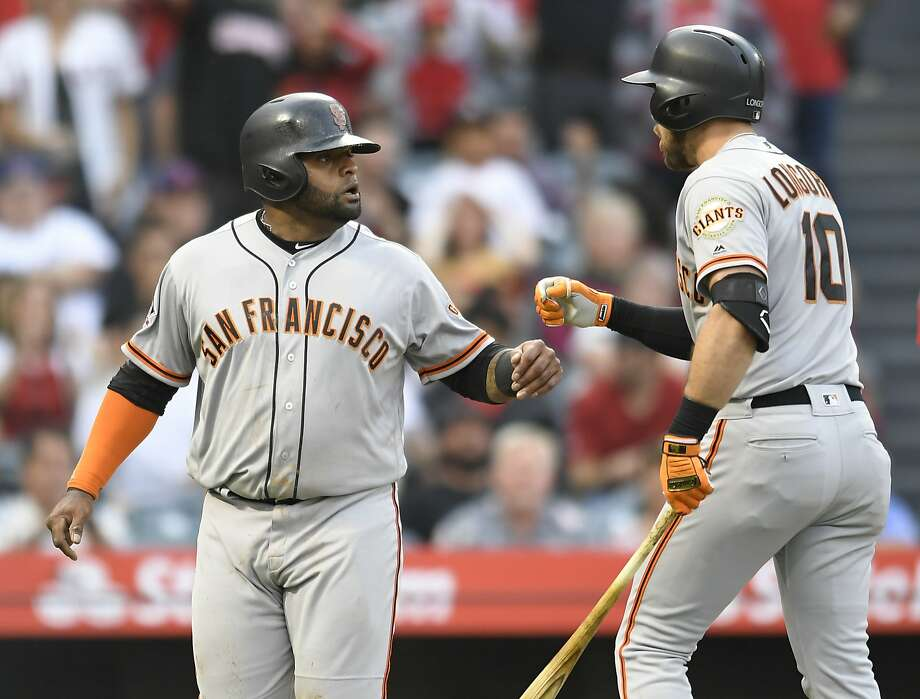 ANAHEIM, CA - APRIL 21:  Third baseman Pablo Sandoval #48 of the San Francisco Giants is congratulated by Evan Longoria #10 after he was driven in on a two-run home run by first baseman Brandon Belt #9 in the second inning at Angel Stadium on April 21, 2018 in Anaheim, California. (Photo by John McCoy/Getty Images) Photo: John McCoy / Getty Images