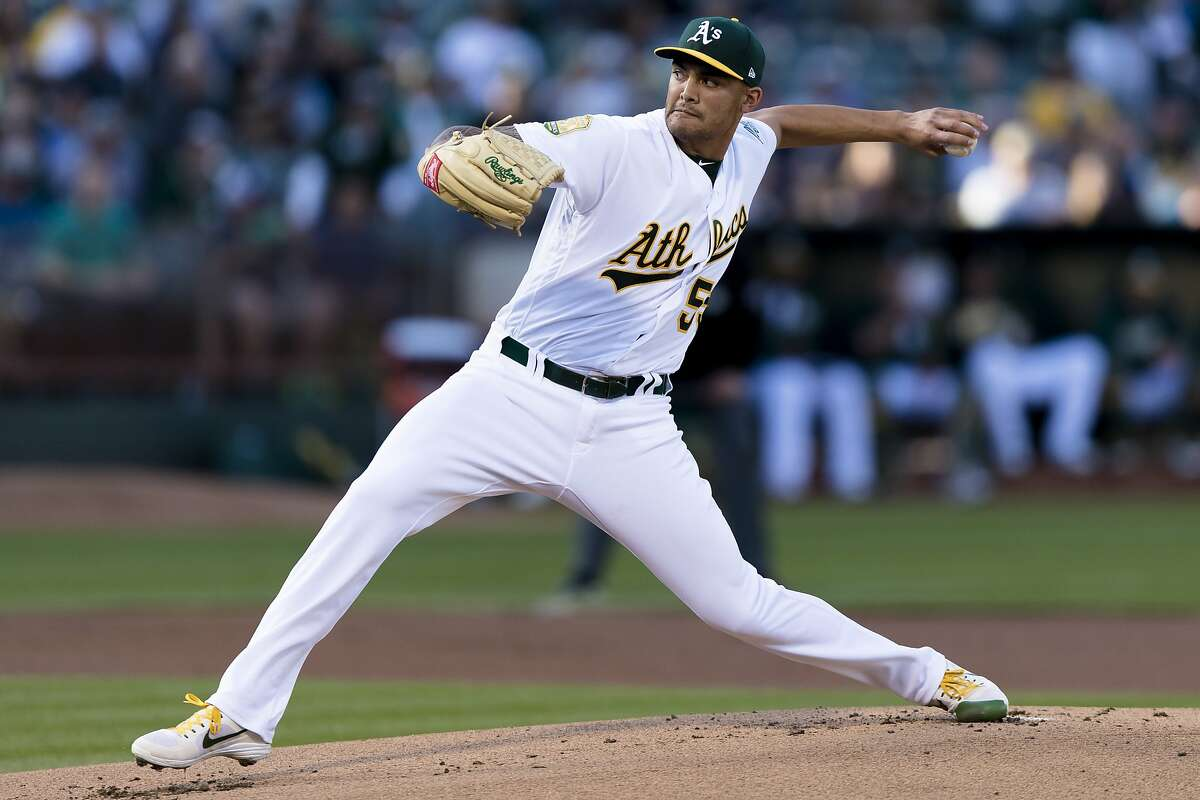Oakland Athletics starting pitcher Sean Manaea throws against a Boston Red Sox batter in the first inning of a baseball game in Oakland, Saturday, April 21, 2018. (AP Photo/John Hefti)