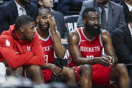 Houston Rockets guard Chris Paul (3) and guard James Harden (13) sit next to each other on the bench at the end of the game as the Houston Rockets lose to the Minnesota Timberwolves 121-105 in Game 3 of the first round of the NBA Playoffs at Target Center Saturday, April 21, 2018 in Minneapolis. (Michael Ciaglo / Houston Chronicle)