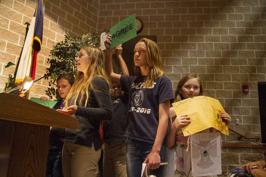 Students from Hill Country Montissori School speak in opposition of a concrete batch plant by Vulcan Materials at a public hearing held by the Texas Commission on Environmental Quality, Thursday, April 19, 2018 at Boerne Middle School North. Photo: Alma E. Hernandez, For The San Antonio Express News / Alma E. Hernandez / For The San Antonio Express News