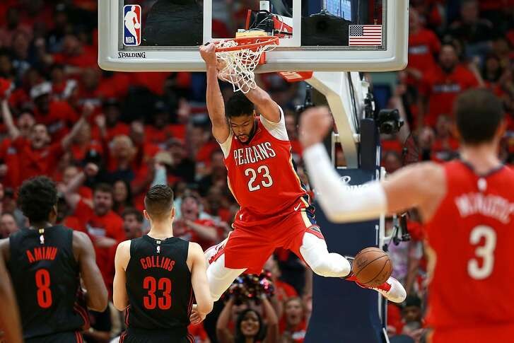 NEW ORLEANS, LA - APRIL 19:  Anthony Davis #23 of the New Orleans Pelicans dunks the ball against the Portland Trail Blazers during Game 3 of the Western Conference playoffs against the Portland Trail Blazers at the Smoothie King Center on April 19, 2018 in New Orleans, Louisiana. NOTE TO USER: User expressly acknowledges and agrees that, by downloading and or using this photograph, User is consenting to the terms and conditions of the Getty Images License Agreement.  (Photo by Sean Gardner/Getty Images)