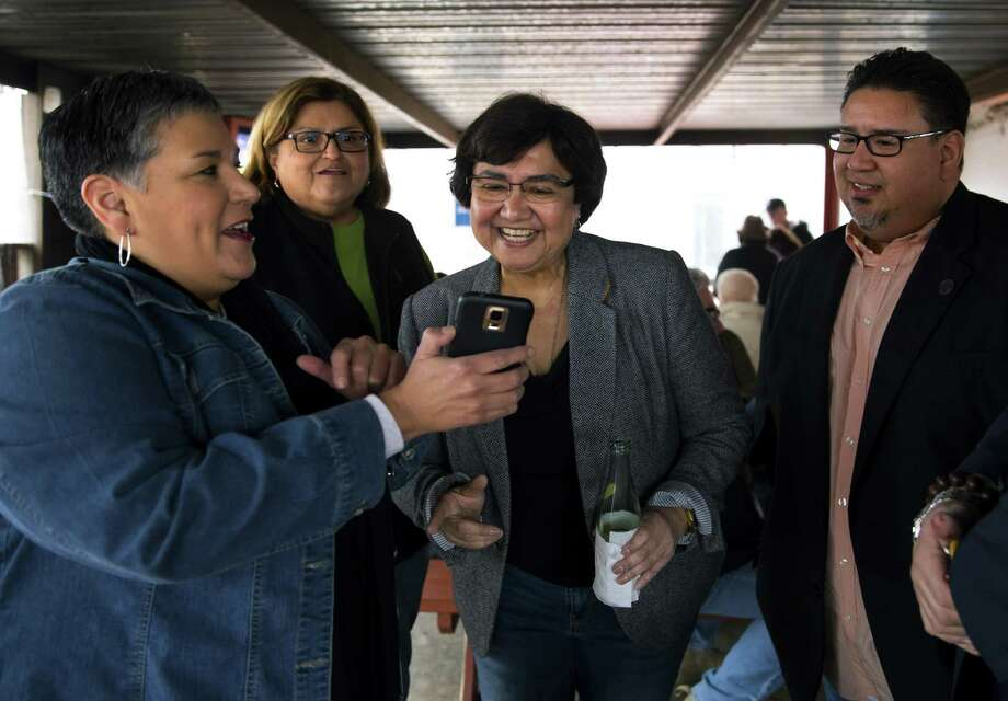 Sylvia Medellin shows her phone to Democratic gubernatorial candidate Lupe Valdez during a meet-and-greet at the West Alabama Ice House on Saturday, Feb. 03, 2017. (Annie Mulligan / Freelance) Photo: Annie Mulligan, Freelance / Annie Mulligan / @ 2016 Annie Mulligan