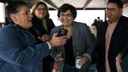 Sylvia Medellin shows her phone to Democratic gubernatorial candidate Lupe Valdez during a meet-and-greet at the West Alabama Ice House on Saturday, Feb. 03, 2017. (Annie Mulligan / Freelance)