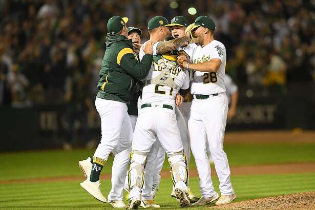 OAKLAND, CA - APRIL 21:  Sean Manaea #55 of the Oakland Athletics (C) celebrates with his teammates after he pitched a no-hitter against the Boston Red Sox at the Oakland Alameda Coliseum on April 21, 2018 in Oakland, California. The Athletics won the game 3-0.  (Photo by Thearon W. Henderson/Getty Images)