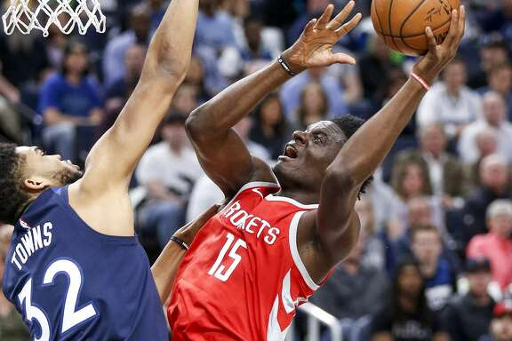 Houston Rockets center Clint Capela (15) takes a shot over Minnesota Timberwolves center Karl-Anthony Towns (32) as the Houston Rockets take on the Minnesota Timberwolves in Game 3 of the first round of the NBA Playoffs at Target Center Saturday, April 21, 2018 in Minneapolis. (Michael Ciaglo / Houston Chronicle)