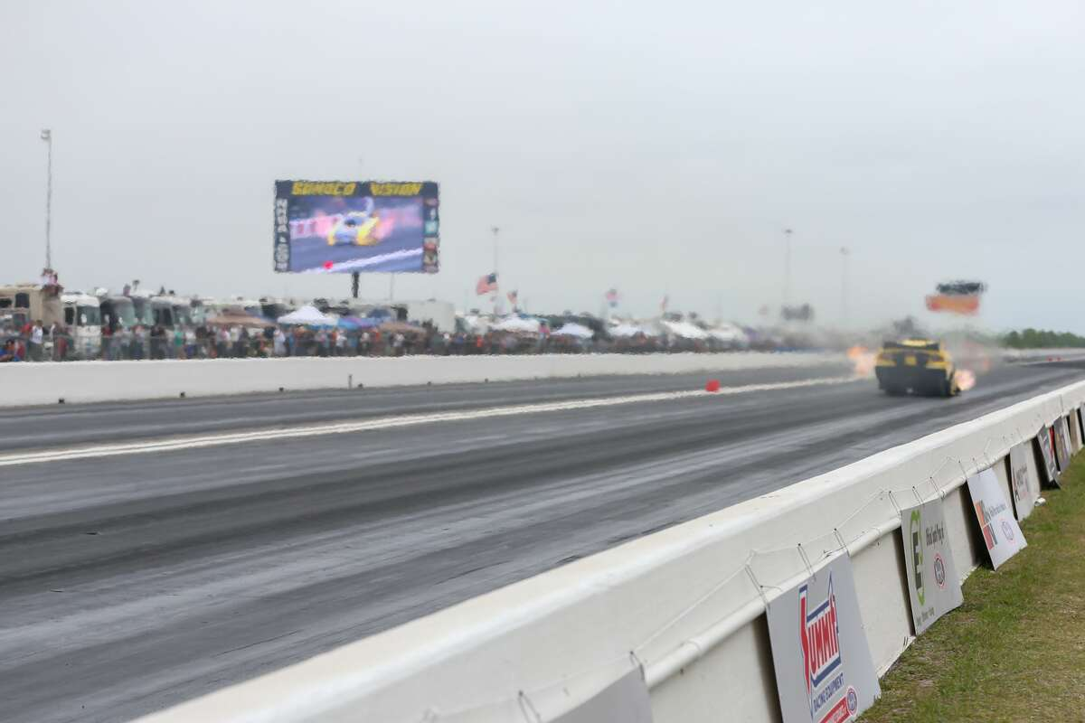 April 21, 2018: Funny cars race down the track during the second day of the NHRA Spring National races at the Royal Purple Raceway in Baytown, Texas. (Leslie Plaza Johnson/Freelance