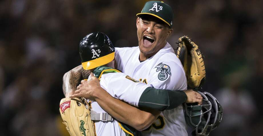 Oakland Athletics starting pitcher Sean Manaea, right, celebrates with catcher Jonathan Lucroy after pitching a no-hitter against the Boston Red Sox during a baseball game in Oakland, Calif., Saturday, April 21, 2018. The A's won 3-0. (AP Photo/John Hefti) Photo: John Hefti/Associated Press