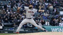 Houston Astros starting pitcher Dallas Keuchel throws against the Chicago White Sox during the first inning of a baseball game Saturday, April 21, 2018, in Chicago. (AP Photo/Nam Y. Huh)