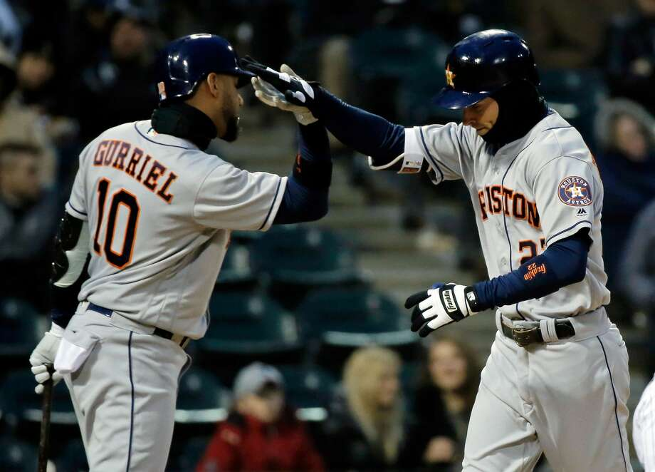 CHICAGO, IL - APRIL 21: Josh Reddick #22 of the Houston Astros is congratulated by Yuli Gurriel #10 (L) after hitting a home run against the Chicago White Sox during the fourth inning at Guaranteed Rate Field on April 21, 2018 in Chicago, Illinois.  (Photo by Jon Durr/Getty Images) Photo: Jon Durr/Getty Images