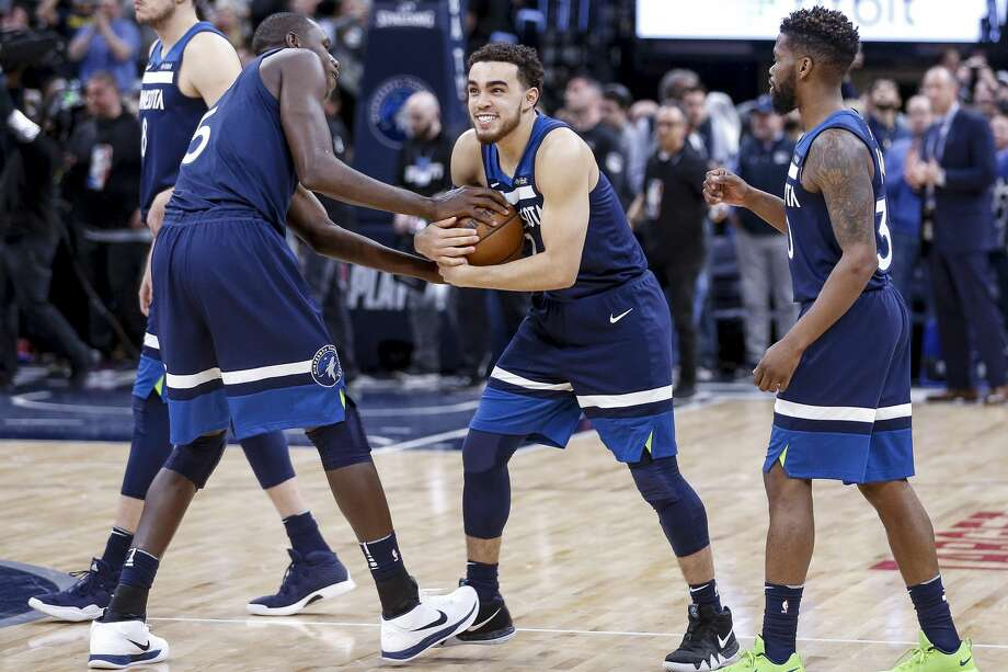 Minnesota Timberwolves guard Tyus Jones (1) tries to keep the game winning ball from center Gorgui Dieng (5) as they beat the Houston Rockets 121-105 in Game 3 of the first round of the NBA Playoffs at Target Center Saturday, April 21, 2018 in Minneapolis. (Michael Ciaglo / Houston Chronicle) Photo: Michael Ciaglo/Houston Chronicle