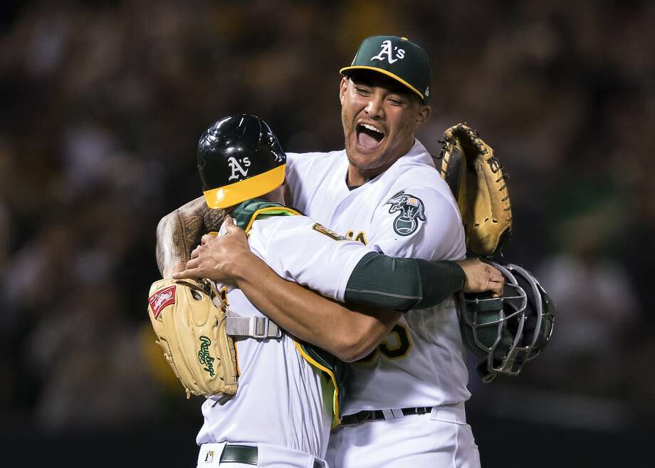 Oakland Athletics starting pitcher Sean Manaea, right, celebrates with catcher Jonathan Lucroy after pitching a no-hitter against the Boston Red Sox during a baseball game in Oakland, Calif., Saturday, April 21, 2018. The A's won 3-0. (AP Photo/John Hefti) Photo: John Hefti, Associated Press
