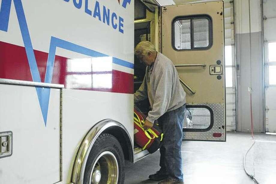 LifeStar Ambulance manager Dave Goss checks equipment in an ambulance Saturday at the ambulance garage at 524 S. Main St. Photo:       Greg Olson | Journal-Courier