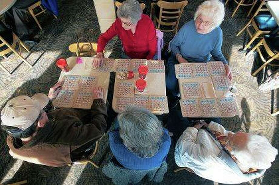 Participants in morning bingo at Wendy's in Galesburg mark their cards during a game. It's become a weekly tradition at the restaurant with people from their 30s to their 90s playing. Instead of putting in money for a potentially big payout, everyone vies for the chance to get a free hamburger, Frosty or order of fries as a reward. Photo:       Steve Davis | The Register-Mail (AP)