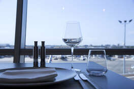 A table setting is seen inside the American Airlines Flagship First Dining room at John F. Kennedy International Airport in New York.