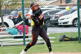 Edwardsville's Maria Smith triples in her first-inning at-bat against East St. Louis in Game 1 of a Saturday doubleheader.