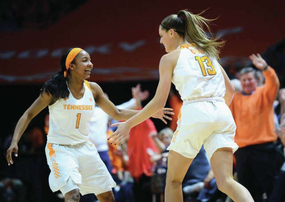 Tennessee's Kortney Dunbar (right) is congratulated by teammate Anastasia Hayes after making a 3-pointer late in the Vols' 65-46 win over South Carolina. Photo: Associated Press