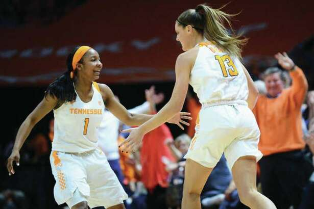 Tennessee's Kortney Dunbar (right) is congratulated by teammate Anastasia Hayes after making a 3-pointer late in the Vols' 65-46 win over South Carolina.