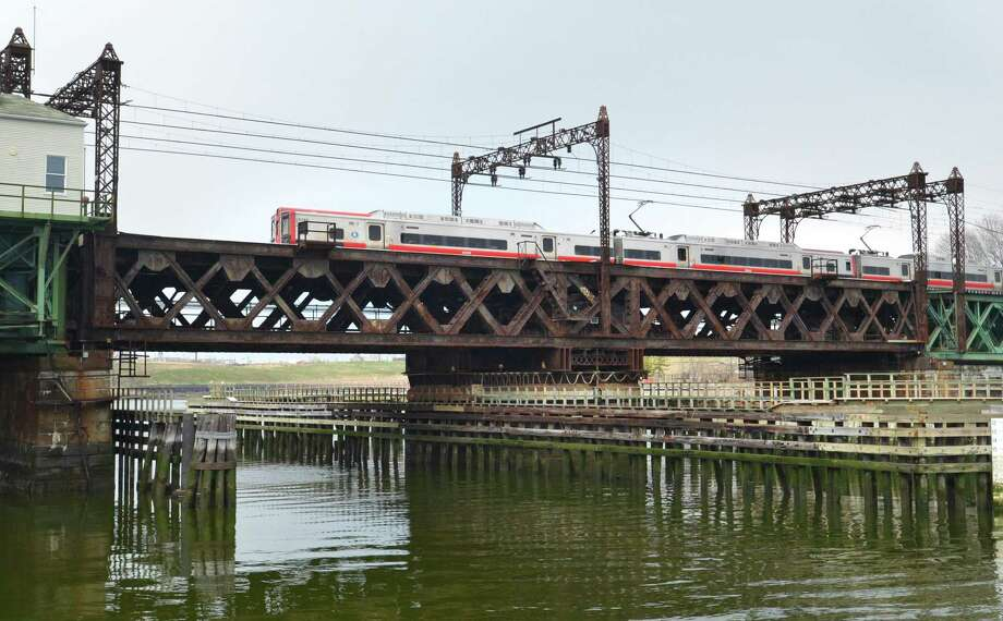 A Metro-North train crosses the Walk Bridge over the Norwalk River on Thursday April 12, 2018 in Norwalk Conn. Photo: Alex Von Kleydorff / Hearst Connecticut Media / Norwalk Hour
