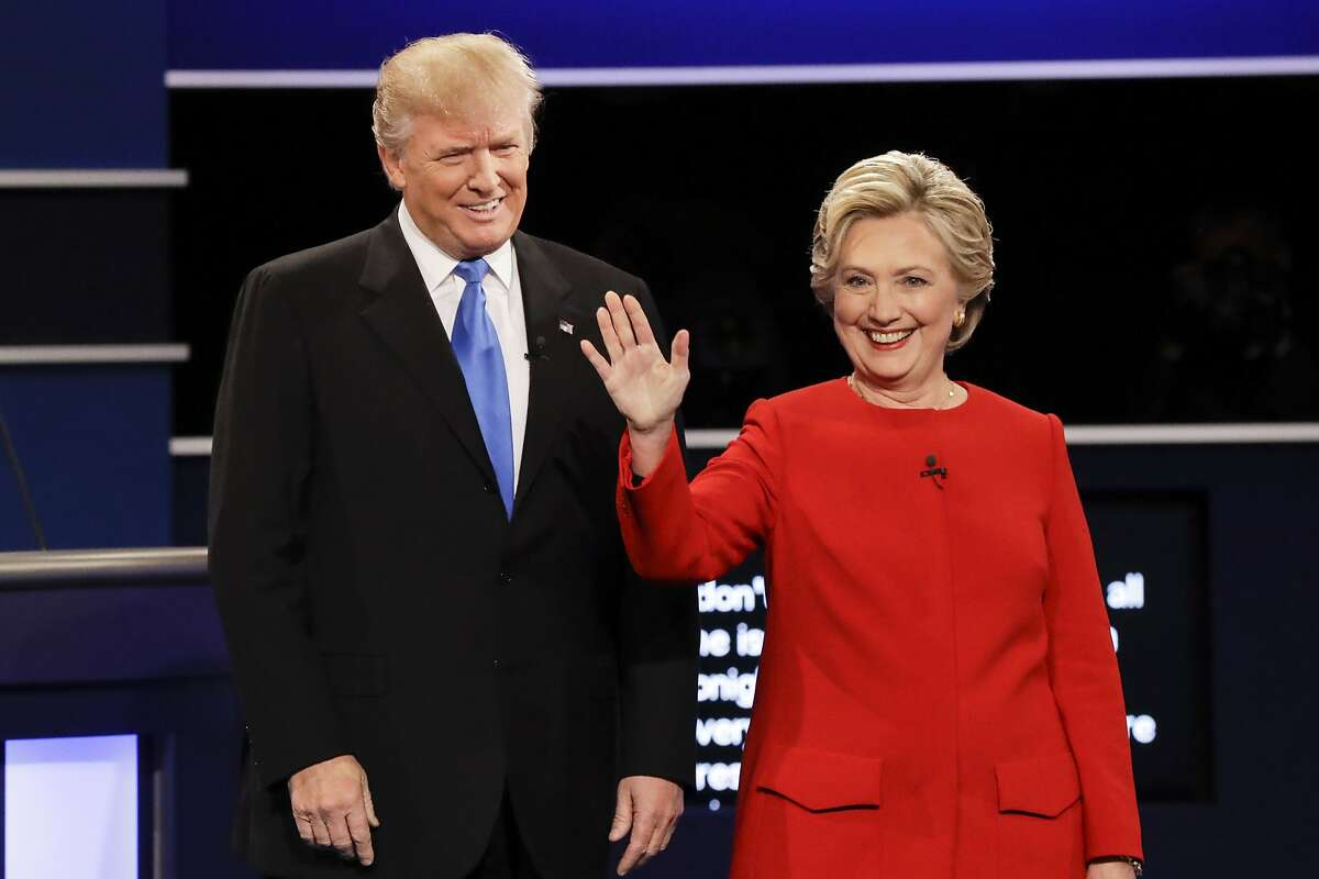 FILE - In this Sept. 26, 2016, file photo, then-Republican presidential nominee Donald Trump and then-Democratic presidential nominee Hillary Clinton are introduced during the presidential debate at Hofstra University in Hempstead, N.Y. Almost 18 months have passed since Clinton lost the presidency. She holds no position of power in government or in her political party. And she is not expected to run for office ever again. Yet Clinton is starring in the Republican Party�s 2018 midterm strategy. (AP Photo/David Goldman, File)