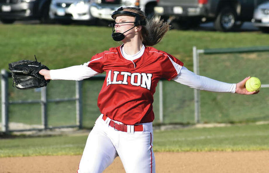 Alton pitcher Alyson Haegele, shown working in a game against Edwardsville earlier this season in Godfrey, picked up both wins in the circle Saturday in the Redbirds' doubleheader sweep of Quincy. Photo:       Matthew Kamp / Hearst Newspapers