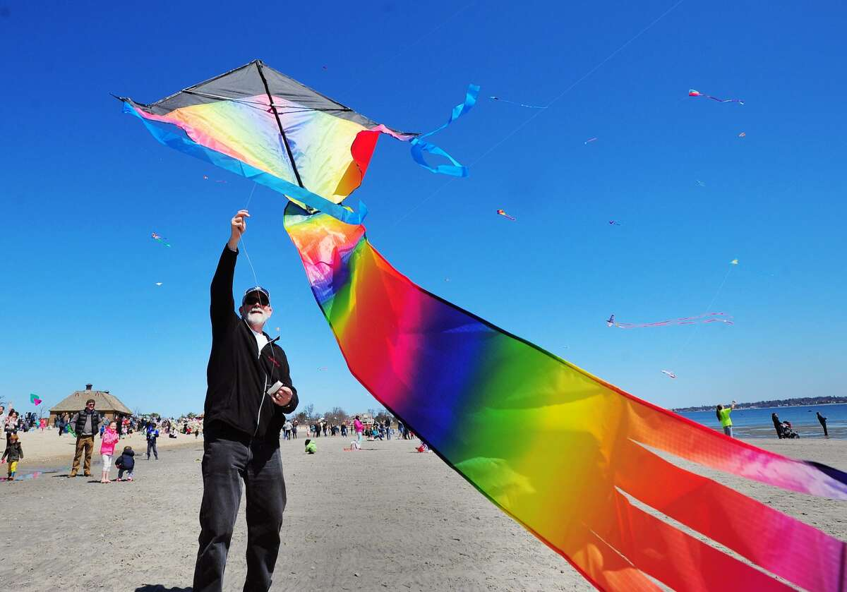 Brian Gilmartin of Greenwich launched a rainbow kite into the air during the annual Greenwich Kite Flying Festival on the beach at Greenwich Point, Conn., Saturday, April 21, 2018. The event is hosted by the Department of Parks and Recreation, the India Cultural Center of Greenwich, and the Greenwich Arts Council.