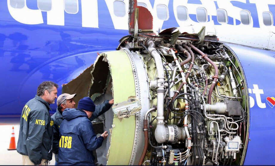 National Transportation Safety Board investigators inspect the Southwest Airlines engine that exploded in flight April 17. Photo: NTSB / National Transportation Safety Board