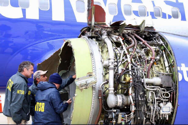 National Transportation Safety Board investigators inspect the Southwest Airlines engine that exploded in flight April 17.
