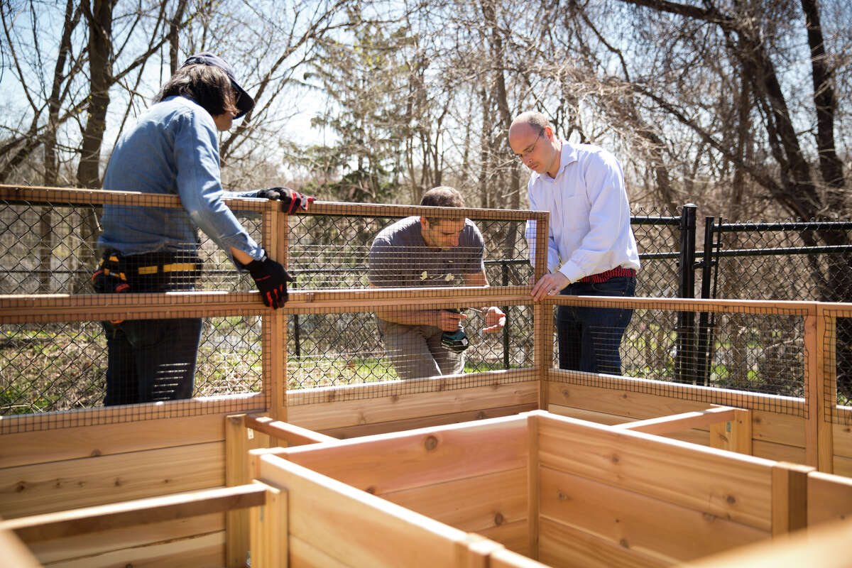 Volunteers Akira Tsuruoka, Ari Weinberg and Alex Gitelman construct a raised garden at the Temple Sholom Selma Maisel Nursery School in Greenwich, Conn. on Sunday, April 22, 2018. The 8' x 8' raised garden bed will serve as a sensory-rich space to promote student inquiry, dialogue and critical thinking.