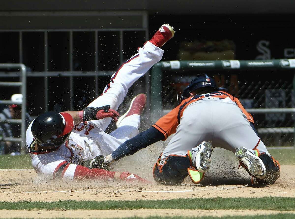 CHICAGO, IL - APRIL 22: Max Stassi #12 of the Houston Astros tags out Yoan Moncada #10 of the Chicago White Sox at home plate during the third inning on April 22, 2018 at Guaranteed Rate Field in Chicago, Illinois.