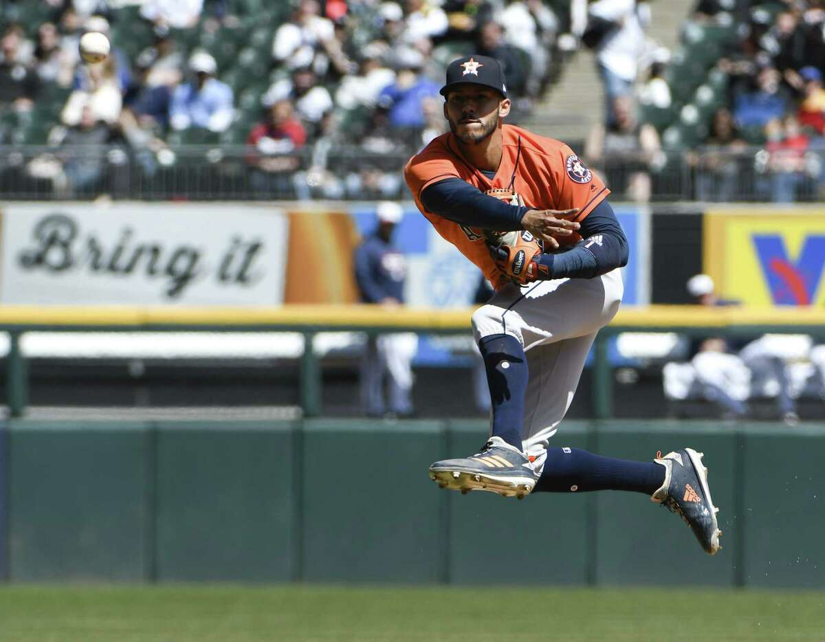 CHICAGO, IL - APRIL 22: Carlos Correa #1 of the Houston Astros throws out Leury Garcia #28 of the Chicago White Sox during the third inning on April 22, 2018 at Guaranteed Rate Field in Chicago, Illinois.