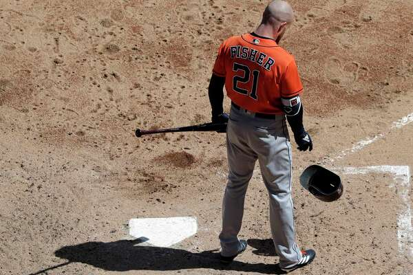 Houston Astros' Derek Fisher drops his helmet after striking out swinging against the Chicago White Sox during the fourth inning of a baseball game Sunday, April 22, 2018, in Chicago. (AP Photo/Nam Y. Huh)