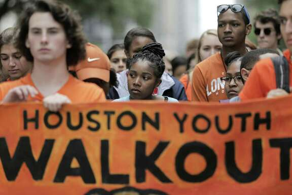 High school students on Friday wait in silence before walking after the presentation during the Houston Youth Walkout, a march to coincide with the anniversary of Columbine High School shooting.