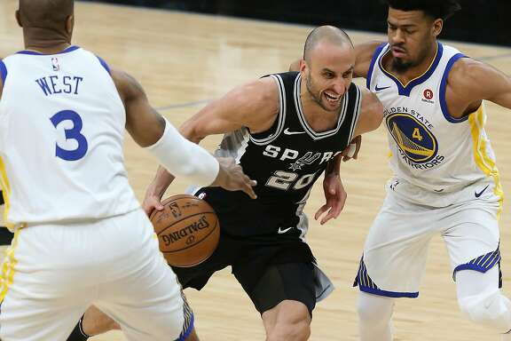 San Antonio Spurs� Manu Ginobili tries to get between Golden State Warriors� David West and Quinn Cook during the first half at the AT&T Center, Sunday, April 22, 2018.